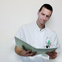 Nederland, Amsterdam , 8 december 2014.<br /> Frank Oosterveer, physician assistant afdeling longziekten VUmc<br /> Foto:Jean-Pierre Jans