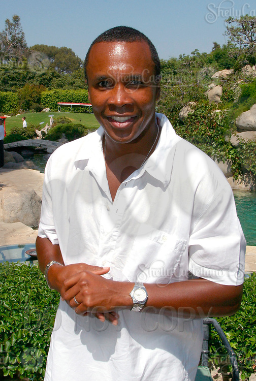 Jul 09, 2002; Los Angeles, CA, USA; Boxer SUGAR RAY LEONARD celebrating his one year anniversary as a boxing promoter with a live fight night on ESPN2 from the Playboy Mansion in Holmby Hills.  Over 350 invited guests attended the cocktail reception and showdown in the back yard of Playboy HUGH HEFNER's 5.5 acre estate. <br />Mandatory Credit: Photo by Shelly Castellano/ZUMA Press.<br />(©) Copyright 2002 by Shelly Castellano