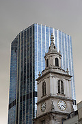 Old and new buildings in the City of London, UK. Glass and traditional buildings mixing together as architecture in the square mile continues its development.