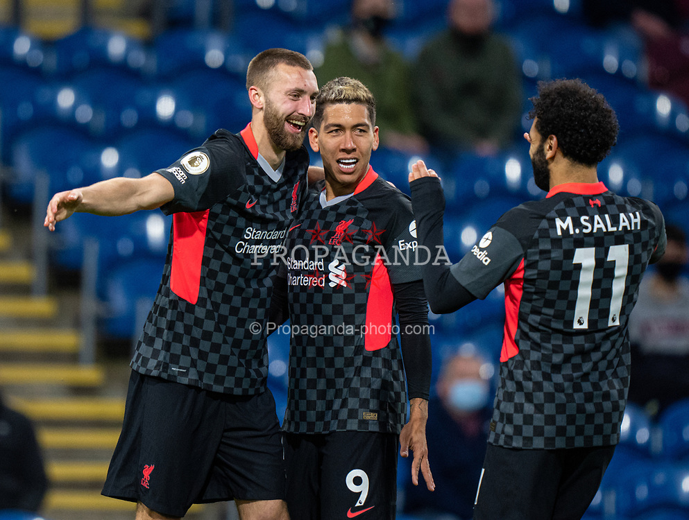 BURNLEY, ENGLAND - Wednesday, May 19, 2021: Liverpool's Nathaniel Phillips (L) celebrates after scoring the second goal with team-mates Roberto Firmino (C) and Mohamed Salah (R) during the FA Premier League match between Burnley FC and Liverpool FC at Turf Moor. Liverpool won 3-0. (Pic by David Rawcliffe/Propaganda)