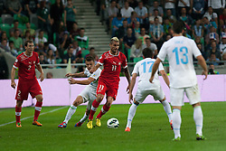 Zlatko Dedic of Slovenia and Valon Behrami of Switzerland during qualification football match for World Cup 2014 in Brazil between national team of Slovenia and Switzerland, on September 7, 2012 in Ljubljana, Slovenia. (Photo by Matic Klansek Velej / Sportida.com)