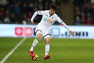 Ki Sung-Yueng of Swansea city in action.Premier league match, Swansea city v West Bromwich Albion at the Liberty Stadium in Swansea, South Wales on Saturday 9th December 2017.<br /> pic by  Andrew Orchard, Andrew Orchard sports photography.