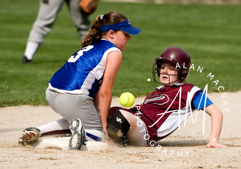 Merrimack County Savings' Sam Curran slides safely into second as PIP shortstop Sammy LaRochelle fumbles the catch during Saturday's Towle Cup Championship at Sanel Field.   (Alan MacRae/for the Monitor)