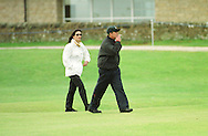 Catherine Zeta-Jones and husband Michael Douglas pictured  at the Old Course, St. Andrews during the actor's round at the annual Dunhill pro-celebrity golf tournament where he partnered Ernie Els.