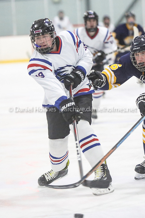 (12/19/18, HOPEDALE, MA) Hopedale-Millis' Nick Patterson takes a shot that is deflected during the boys hockey game against Littleton-Bromfield at Blackstone Valley Ice Arena in Hopedale on Wednesday. [Daily News and Wicked Local Photo/Dan Holmes]