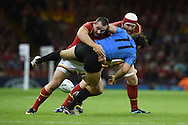 Rodrigo Silva of Uruguay is tackled by Ken Owens and Jake Ball of Wales. Rugby World Cup 2015 pool A match, Wales v Uruguay at the Millennium Stadium in Cardiff, South Wales  on Sunday 20th September 2015.<br /> pic by  Andrew Orchard, Andrew Orchard sports photography.