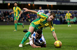 Queens Park Rangers' Massimo Luongo (floor) is taken down inside the box by West Bromwich Albion's Craig Dawson during the Sky Bet Championship match at Loftus Road, London.