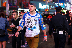 © Licensed to London News Pictures. 09/11/2016. New York CIty, USA. A man wearing a pro-Hillary Clinton t-shirt reacts to news that Donald Trump is elected as the next president of the United States, while gathering in Times Square, New York City, on Wednesday, 9 November. Photo credit: Tolga Akmen/LNP