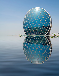 Unusual modern architecture of headquarters building for Aldar in Abu Dhabi United Arab emirates UAE