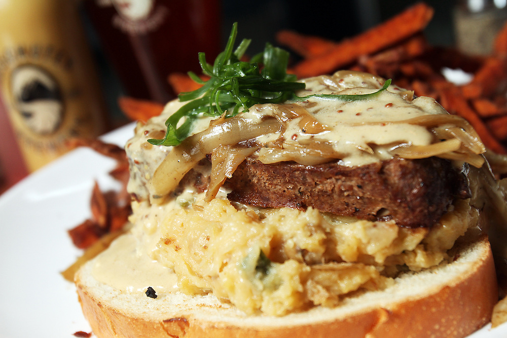 """A special of elk meatloaf with mustard cream sauce, caramelized onions, garlic mashed potatoes, challah and sweet potato fries. """"Elk is popular in our burgers here, so we're testing it out in the meatloaf, too,"""" said sous chef Chad Berg. """"I just love it with the mustard cream sauce."""" Craft beer permeates the culture in Central Oregon city of Bend, with 10 breweries serving pints, growlers and kegs to a community of less than 90,000. Photographed Wednesday, April 25, 2012. Assignment ID 30125094A"""