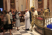 Holy communion Roman Catholic mass priest and nun in cathedral church, city of Valencia, Spain