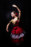 SYRACUSE, NY – DECEMBER 2, 2010: BalletMet dancer Bethany Lee poses as Spanish Doll before a performance of The Nutcracker at the John H. Mulroy Civic Center.