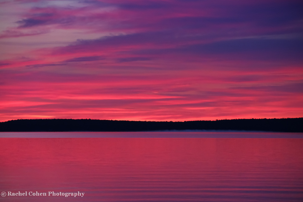 """""""Dawn's Early Light""""<br /> <br /> Beautiful pink and purple hues and Mackinac Island in silhouette in a lovely sunrise image over Lake Huron in Michigan's Upper Peninsula!<br /> <br /> Sunrise Images by Rachel Cohen"""