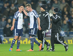 West Bromwich Albion's Chris Brunt leaves the field after picking up an injury - Photo mandatory by-line: Dougie Allward/JMP - Mobile: 07966 386802 - 02/12/2014 - SPORT - Football - West Bromwich - The Hawthorns - West Bromwich Albion v West Ham United - Barclays Premier League