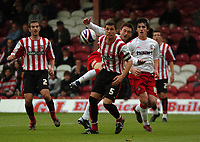 Photo: Tony Oudot.<br /> Brentford v Lincoln City. Coca Cola League 2. 27/10/2007.<br /> Lee Frecklington of Lincoln gets in a shot past John Mackie of Brentford