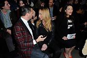 Mercedes-Benz FashionWeek Amsterdam A/W '14  - catwalk Janboelo in de Gashouder, Westergasterrein Amsterdam.<br /> <br /> Mercedes-Benz Fashion Week Amsterdam A / W '14 - Janboelo catwalk in the Gasometer, Westergasterrein Amsterdam.<br /> <br /> op de foto:  Patty Zomer ,  Fred van Leer en Caro Emerald ( zwanger )