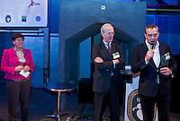 UTRECHT -  NGF ontvangt NVG Award. Jacqueline Lambrechtse (l) , voorzitter NVG met Ronald Pfeifffer (voorzitter NGF) en Paul Wessel (bestuurslid NVG) , A tribe called Golf, de kracht van de connectie. Nationaal Golf Congres van de NVG 2014 , Nederlandse Vereniging Golfbranche. COPYRIGHT KOEN SUYK