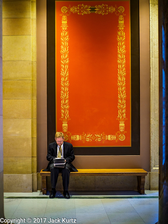 01 MAY 2017 - ST. PAUL, MN: A man works in a hallway at the Minnesota State Capitol in St. Paul, MN.       PHOTO BY JACK KURTZ