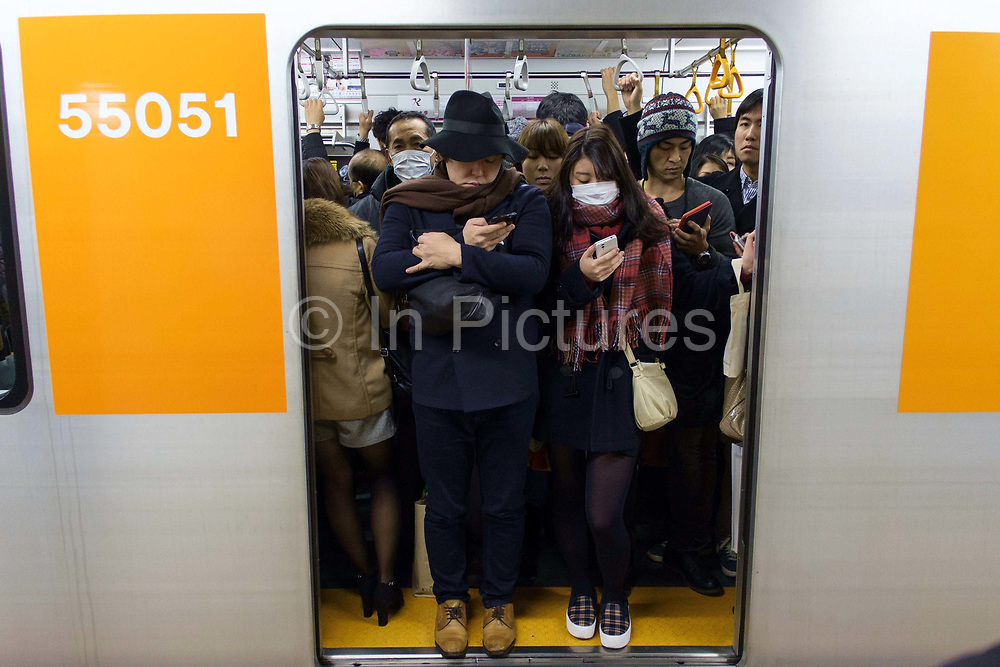 Commuters crowded onto the Tokyo subway. The combined subway network of the Tokyo and Toei metros comprises 290 stations and 13 lines. Some 8.7 million passengers travel on the subway each day. Japan.