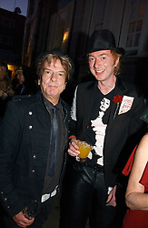 Left to right, NICKY HASLAM and TOM BAKER at a party to celebrate Stephen Jones's 25 Years of Millinery held at Debenham House, 8 Addison Road, London W14 on 13th July 2006.<br /><br />NON EXCLUSIVE - WORLD RIGHTS