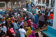 Travelers crowd onto ferries at the Sadarghat dock on the Buriganga River in Dhaka, Bangladesh. The river acts as both a highway and a sewer, with 80 percent of the city's raw sewage draining into the river.
