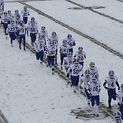Darien players head for the sideline for the start of the second half during the New Canaan Rams Vs Darien Blue Wave, CIAC Football Championship Class L Final at Boyle Stadium, Stamford. The New Canaan Rams won the match in snowy conditions 44-12. Stamford,  Connecticut, USA. 14th December 2013. Photo Tim Clayton