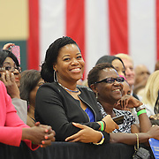 """Supporters smile prior to the """"Commit to Vote"""" rally for Democrat Charlie Crist who is running for Governor of the state of Florida. The campaign called on the event to """" energize voters and lay out the stakes for Floridians in the critical election on November 4th."""" at the Barnett Park Gymnasium in Orlando, Florida on Friday, Nov. 17, 2014. (AP Photo/Alex Menendez)"""