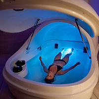 A customer enjoys a relaxing float at TruRest Float Spa in Wilmington, NC.