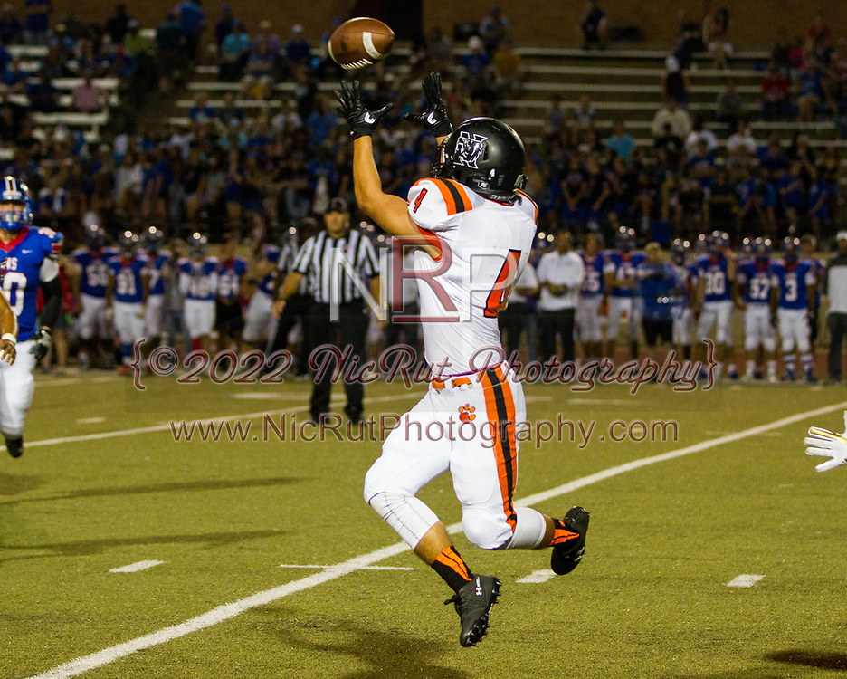 Tyler Crump (#4) leaping to a big Tigers first down play in the 4th quarter.