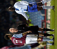 Photo: Richard Lane.<br />Aston Villa v Chelsea. Carling Cup. 17/12/2003.<br />Jimmy Floyd Hasselbaink and Ronnie Johnsen argue as Neal Barry waits to have a word.