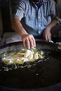 A man fries samosas at the Old and Famous Jalebi Wala (at the corner of Dariba Kalan and Chandni Chowk). Delhi, India