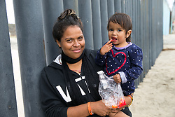 EXCLUSIVE: Men, Women and Children from Honduras and Guatemala, who have fled their country and travelled to the US Border in Tijuana Mexico, look through the bars at the beach in Tijuana and congregate at a local sports field in makeshift shelters. 20 Nov 2018 Pictured: Migrant caravan. Photo credit: MEGA TheMegaAgency.com +1 888 505 6342
