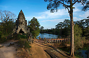 The South Gate is the most well known of the 5. It is the main entrance and gateway for tourists into the great Angkor Thom. During peak seasons, this gate can be extremely crowded and don't be surprised if you see a small traffic jam of tuk-tuks here. It provides the most common access route to Angkor Thom, predominantly because it sits on the path between the two great Angkor complexes. The gate is a wonderful introduction to Angkor Thom, with well-restored statues of asuras (demons) and gods lining the bridge. The figures on the left, exhibiting serene expression, are the gods, while those on the right, with grimaced, fierce-looking heads, are the asuras.