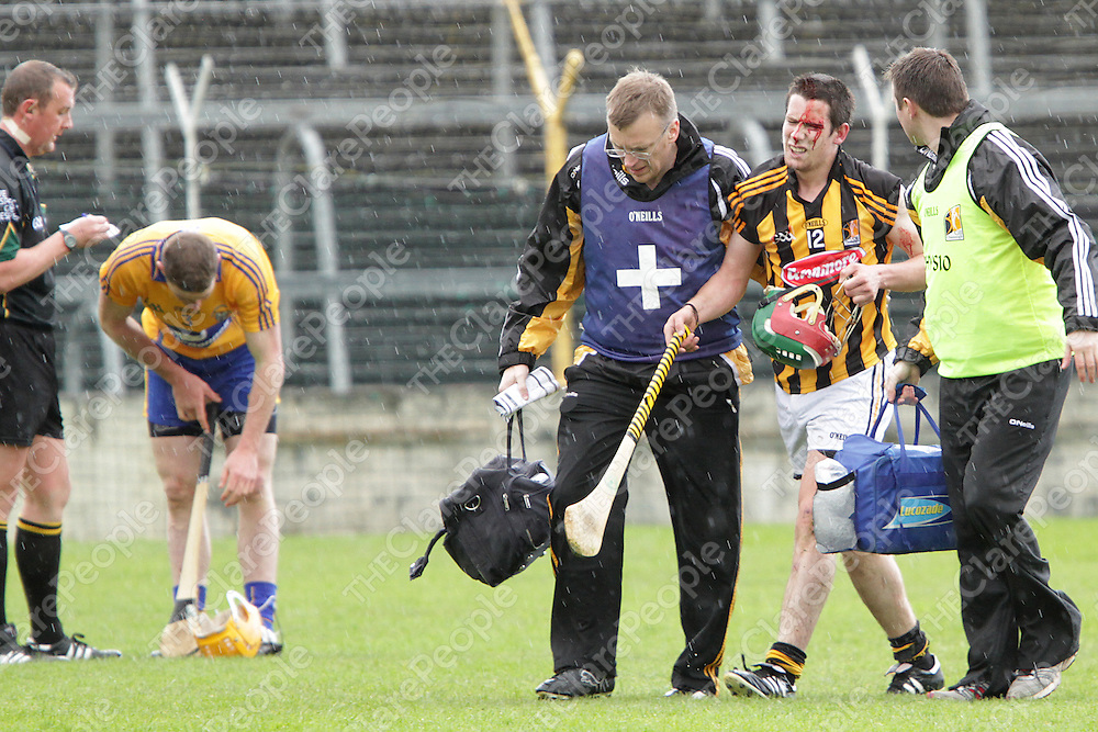 A bloodied John Mulhall Kilkenny leaves the field for repairs as referee Alan Kelly books Cian Dillon for the challenge in the Allianz Hurling League Semi-Final @ Thurles.<br /> Photograph by Flann Howard