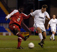 Photo. Jed Wee.<br /> Tranmere Rovers v Bristol City, Nationwide League Division Two, Prenton Park, Liverpool. 24/03/2004.<br /> Bristol's Clayton Fortune (L) fires in a shot while Tranmere's Ian Sharpes tries to block it.