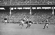 Kerry player attempts to grab the ball from a Down players hands during the All Ireland Senior Gaelic Football Final Kerry v Down in Croke Park on the 22nd September 1968. Down 2-12 Kerry 1-13.
