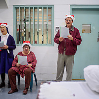 Sister Elizabeth Racko, left, CoraLee Baughman and Jim Cox sing Christmas Carols for prisoners inside the McKinley County Adult Detention Center in Gallup Wednesday.