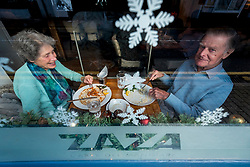 © Licensed to London News Pictures. 15/12/2020. RICKMANSWORTH, UK. A couple dine at a branch of Zaza, an Italian restaurant, in Rickmansworth, Hertfordshire.  The historic town will be elevated to Tier 3 Covid Alert Level tomorrow, as part of the Three Rivers District Council area joining London and other areas of the South East as the number of coronavirus cases continues to rise. In Tier 3, restaurants will only be able to serve takeaway food.  Photo credit: Stephen Chung/LNP