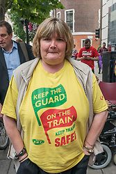 July 20, 2017 - London, UK - London, UK. July 20th 2017. Paula Peters of DPAC (Disabled People Against Cuts) wears an RMT t-shirt for the protest with RMT members outside the Dept of Transport, calling for disabled people to have the same right to use rail services as others. Driver Only Operated trains, the removal of guards from trains and rail staff from stations all threaten their freedom to travel. DPAC have joined with RMT staff on picket lines when they take industrial action against these changes which discriminate against the disabled and threaten to rail safety. After a protest rally with speeches in front of the ministry they delivered a petition demanding their right to ride on trains without having to give a day's notice and then blocked the road outside for ten minutes. Peter Marshall ImagesLive (Credit Image: © Peter Marshall/ImagesLive via ZUMA Wire)