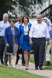 July 24, 2017 - Berryville, Virginia, USA - Senator AMY KLOBUCHAR (D-MN), l, Representative CHERI BUSTOS (D-IL), C, and Senate Democratic Leader CHUCK SCHUMER (D-NY), R, walk through Rose Hill Park in Berryville, Virginia as the Congressional Democratic Leadership announces 'A Better Deal: Better Jobs, Better Wages, Better Future', their new economic agenda. (Credit Image: © Alex Edelman via ZUMA Wire)