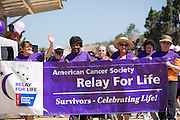 Survivors kick off the opening lap during Relay For Life at the Milpitas Sports Center in Milpitas, California, on June 22, 2013. (Stan Olszewski/SOSKIphoto)