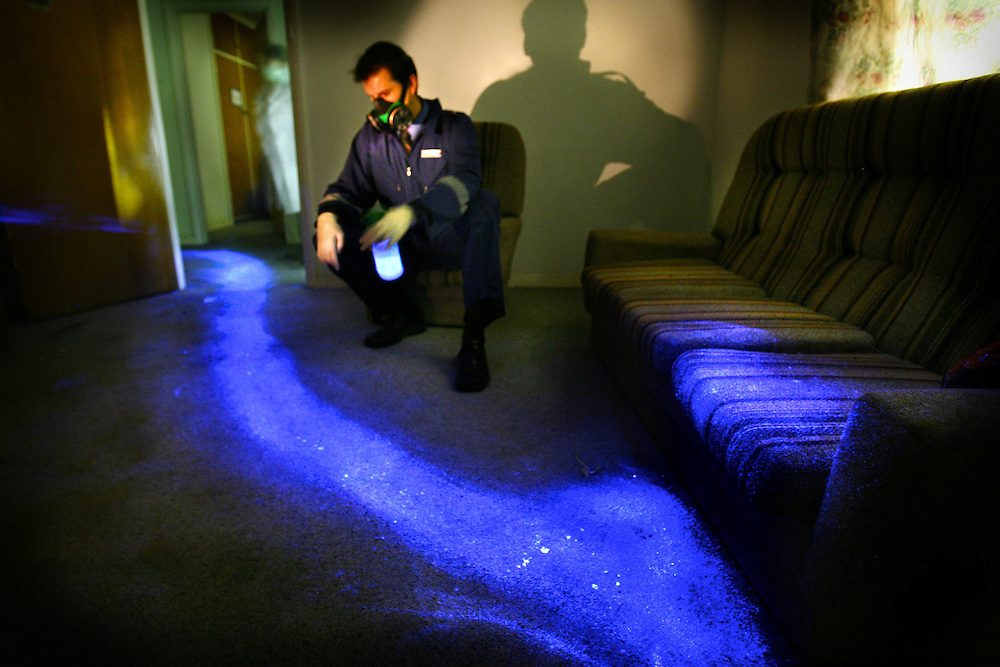 Steven Fowler of police forensics shows how Luminol Blood Detection Reagent Spray shows up bloody drag marks which may be undetectable in daylight. This image of a scene which might be of a location where a person was murdered and dragged away was actually created using pig's blood  Pic By Craig Sillitoe melbourne photographers, commercial photographers, industrial photographers, corporate photographer, architectural photographers, This photograph can be used for non commercial uses with attribution. Credit: Craig Sillitoe Photography / http://www.csillitoe.com<br /> <br /> It is protected under the Creative Commons Attribution-NonCommercial-ShareAlike 4.0 International License. To view a copy of this license, visit http://creativecommons.org/licenses/by-nc-sa/4.0/.