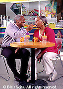 Active Aging Senior Citizens, Retired, Activities, African American Couple Eat in Food Court