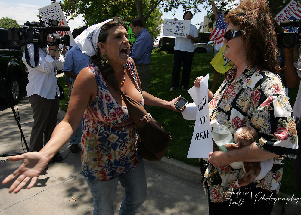 /Andrew Foulk/ For The Californian/ .Joelle Budzynowski, of Anza, a supporter of the Temecula Islamic Center, argues with an opponent of the centers plans to  build of a new mosque in Temecula, during a protest staged outside the center Friday afternoon.