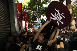 July 1, 2017 - Hong Kong, CHINA - Avery Ng ( C ) pro democratic and social activist, chairman of the LEAGUE OF SOCIAL DEMOCRTS, struggle to protect make-shift Chinese casket amidst scuffle with the pro-China demonstrators who tried to destroy the casket during political rally to condemn visiting Chinese President Xi Jin Ping. Today marks the 20th anniversary of the Hong Kongs HANDOVER to China. July 1, 2017.Hong Kong.ZUMA/Liau Chung Ren (Credit Image: © Liau Chung Ren via ZUMA Wire)