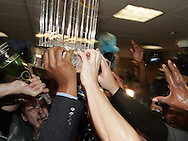 HOUSTON - OCTOBER 26:  Members of the Chicago White Sox celebrate with the World Series trophy after Game 4 of the 2005 World Series against the Houston Astros at Minute Maid Park on October 26, 2005 in Houston, Texas.  The White Sox defeated the Astros 1-0 to become the 2005 World Champions. (Photo by Ron Vesely).