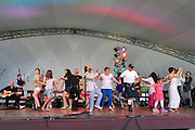 Photo of a group of people from the crowd dancing on the stage at the Dublin Irish Festival in Dublin, Ohio.