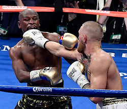 Aug 26,2017.  Las Vegas NV. ( IN blk-gld trunks)  Floyd Mayweather Jr.goes 10 rounds with Conor McGregor  Saturday at the T-Mobile arena in Las Vegas.  Floyd Mayweather Jr. took the win by TKO as the fight was stop in the 10th round. This was Floyd's last fight ending it at 50 wins..Photos by Gene Blevins/LA DailyNews/SCNG/ZumaPress. (Credit Image: © Gene Blevins via ZUMA Wire)
