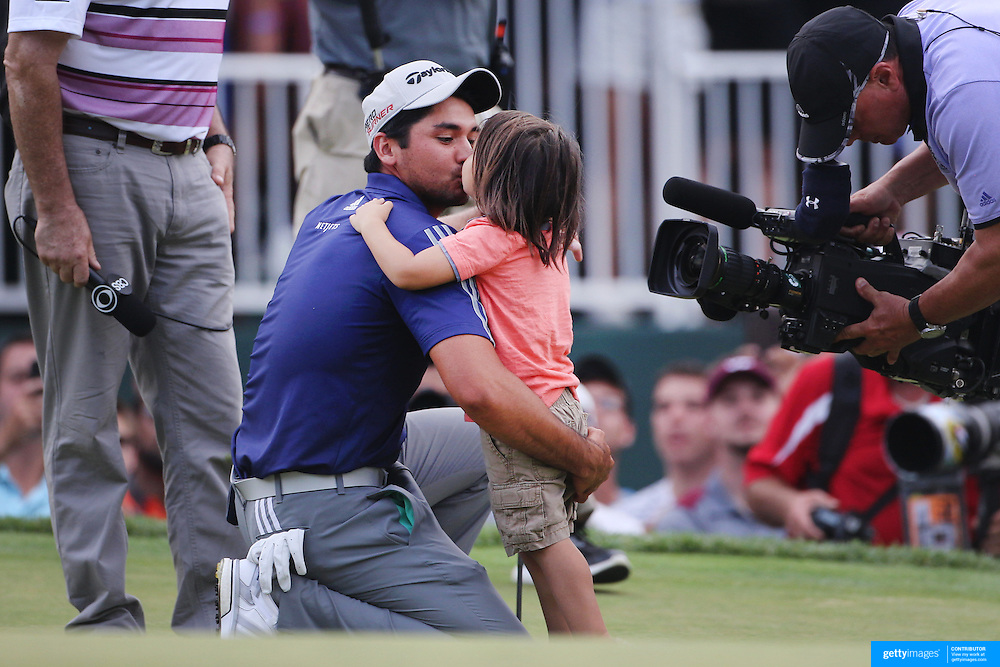 Jason Day, Australia, is greeted by his son Dash after  winning the The Barclays Golf Tournament by six shots at The Plainfield Country Club, Edison, New Jersey, USA. 30th August 2015. Photo Tim Clayton