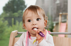 Baby girl 1 year old portrait spoon mouth